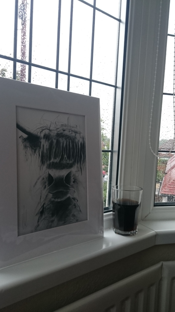 Rainy day window, complete with cow.